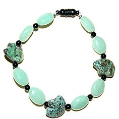Jade Bear is the perfect name for this stylish bracelet by Susen Foster. This bracelet features pale green Aventurine ovals that accent Chinese Turquoise Zuni bears and tiny black onyx gemstones.