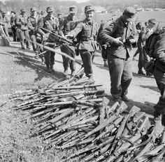 German soldiers give up their weapons at the frontier post of Kruså, Denmark