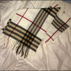 Classic Black, Tan and Red Plaid Scarf Classy and stylish long thin winter scarf. Beautiful soft quality, perfect with a luxe black winter coat and a black fur hat. Fringe on both ends. Never been worn. Kohls Accessories Scarves & Wraps