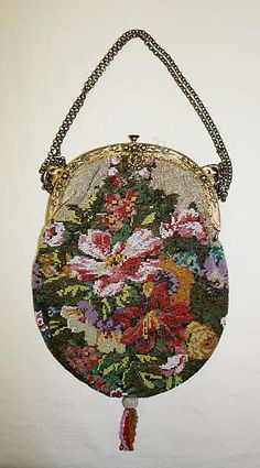 Purse  Date:     19th century Culture:     probably German Medium:     wool, glass, metal Dimensions:     Length: 10 1/4 in. (26 cm...