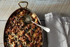 Recipe: Brunch strata with an assortment of cheeses and leafy greens (vegetarian version: simply omit the sausage)
