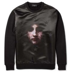 This Givenchy sweater was created by Ricardo Tisci and features a blurry image of The Virgin Mary.