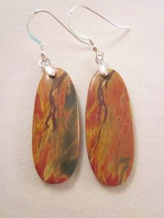 Here we have a set of matched gemstone earrings! Adds a chic and elegant look to any outfit! Picasso Jasper has been used to create this pair