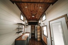 This gorgeous craftsman style tiny house is the Noah by Wind River Tiny Homes. Inside the Noah is a beautiful mix of woods including birch hardwood flooring, knotty pine tongue and groove ceiling, and natural poplar accent walls.