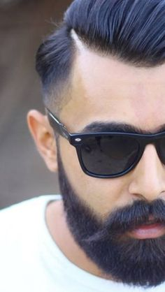 Mister Beard Wash. Softens beard and cleans face. Smells great. http://www.misterbeardwash.com/shop/daily-beard-cleanser-14
