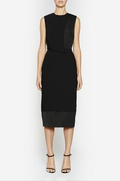 Camilla and Marc | VORTEX DRESS  US$566.49 Classic LBD designed in a black twill with contrasting panels in a textured honeycomb fabric. Created in a streamlined silhouette, this piece features a round neckline, draped front, multi-layered skirt and double slit at the back of the skirt. Includes an invisible zipper fastening at the centre back of the bodice.