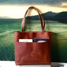 Beautiful, sturdy, brown leather tote in New Proportions ! This bag is so…
