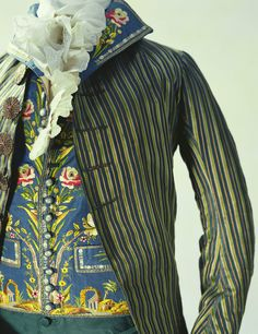 Man's Suit (Detail)  1790  On this waistcoat are delicately embroidered arches and rows of pillars in the style of ancient Rome. During the latter half of the 18th century, under the influence of neoclassicism, ancient Roman and Gothic ruins and remains were frequently adopted as motifs in paintings, garden fixtures, and such.  From the end of the 1780s to the first half of the 1800s, while coats were being simplified, waistcoats were adopting the showier tendencies of men's fashion.