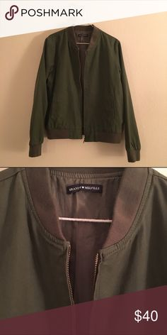 Brandy Melville Bomber Jacket green bomber jacket from Brandy Melville. it's more oversized than the other kasey bomber jacket if any of you are familiar w/ that style (which I also have listed). never worn. Perfect condition. Will fit XS-M. Brandy Melville Jackets & Coats