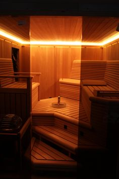 Custom sauna on Staten Island, with custom lighting, sink, and benches