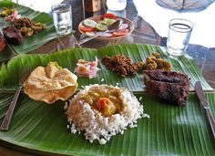 Typical Kerala Meals on plantain leaf with Fish fry/curry