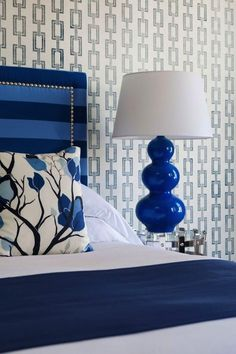 Cobalt blue bedroom accents and geometric wallpaper. #blue #interior #design
