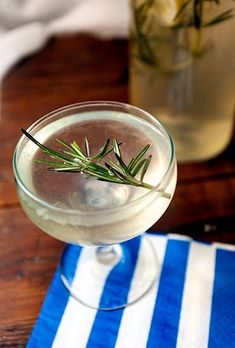 The Best Party Cocktail You'll Ever Have.  Rosemary infused simple syrup, gin, lemon juice and Proseco.  I'll give it a whirl.
