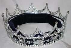 Queen, King Unisex Rhinestone Silver Full Tudor Royal Crown Elegant and regal fully round crown fit for a king or queen. This is the best crown to wear to a homecoming event, parade or carnival. Made
