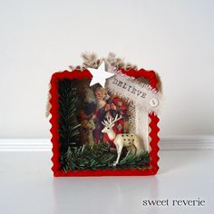 SALE Holiday Christmas Shadow Box - Believe White Reindeer Woodland Winter Scene 3D Mixed Media Collage - Assemblage Box Decoration. $19.50, via Etsy.