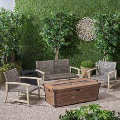 Furnish your patio or backyard space with this charming, hand-woven wicker set and rustic firepit. With a large seating area, this set is perfect for accommodating guests while maintaining a durable structure. This extremely versatile set is perfect for those who love to make things their own.