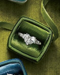 I want a heart shaped engagement ring.. <3  I'd love it in a colored stone too!