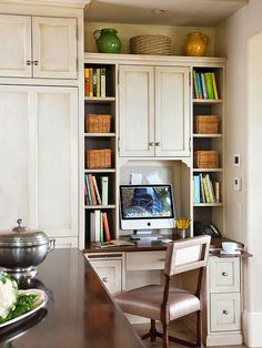 Beautiful and practical, this kitchen features finishes, materials, and designs reminiscent of European kitchens. Kitchen Desks, Kitchen Office, Home Office, Small Office, Office Nook, European Kitchens, Built In Refrigerator, Built In Desk, Upper Cabinets