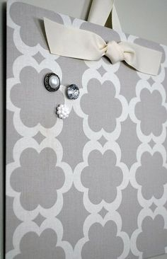 Cover a flat cookie sheet with cute fabric for an instant magnetic board. This is a perfect gift idea for a coworker or a friend who landed a new job!