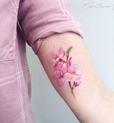 Beautiful watercolor cherry blossom tattoo by Pis Saro