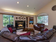 Living Area - Gather around the fireplace on the giant leather sectional sofa.