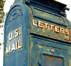 Have a series of photographs of close-ups of old mailboxes and typewriters. Maybe a collection of vintage mailboxes mounted on the wall.