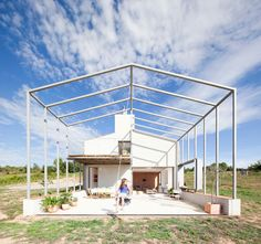anna and eugeni bach attach large frame canopy to country home in spain