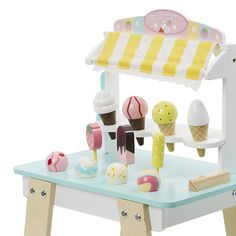 A great way to encourage active and creative play, this Ice Cream stand features 6 different delicious ice creams for your little one to set up shop and sell to friends and family. Containing magnets to hold everything in place, there are hours of fun to be had.