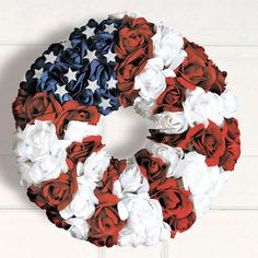 Rosebud Wreath made of lush silk roses with white glitter stars.