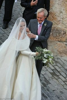 The blushing bride: Accompanied into the church by her proud father the 9th Duke of Wellington, Lady Charlotte Wellesley looked stunning in a white off-the-shoulder dress and veil.