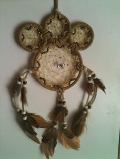 Paw print dream catchers with cat or dog hanging center pendant.