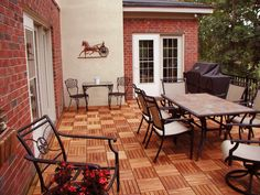 Decor Your Outdoor Patio Using Interlocking Deck Tiles: Interlocking Deck Tile 6 Slat Design FSC Eucalyptus With Rustic Outdoor Chairs And Table