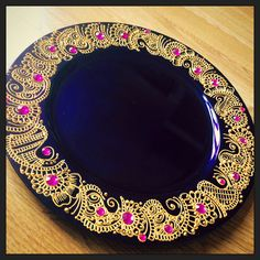 Purple Mehndi thaal decorated using gold acrylic paints and pink gemstones…