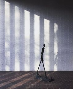 Shadow walker  @frederikkastrupsen's elegant take on #AlbertoGiacometti's bronze sculpture 'Walking Man' (1960) in the #GiacomettiGallery. #LouisianaMuseum #LouisianaCollection by louisianamuseum