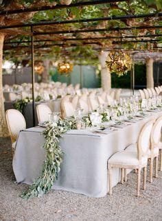 Gorgeous garland table runners: http://www.stylemepretty.com/2016/11/04/biggest-wedding-trends-of-2016/ Photography: Jose Villa - http://josevilla.com/