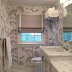 Master bath Reno for my very good client. We love the Cole and Sons Palm Leaf paper we installed !