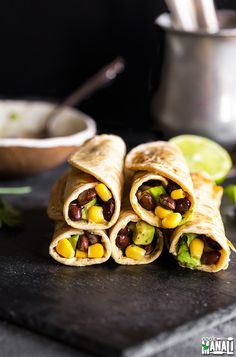 Healthy and Vegan Hummus Roti Rolls filled with black beans, corn & avocados! Find the recipe on www.cookwithmanali.com