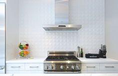 White ceramic tile backsplash in the kitchen adds depth to the setting