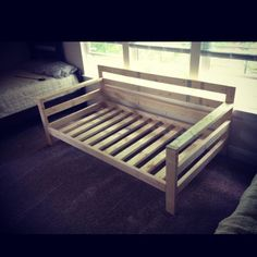 Ana-White inspired couch. Took me 3 hours to make and cost $70. Kreg jigs saved my life!   Using a twin size mattress for the couch! Dimensions are 78 X 35.  DIY!