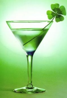 The Green Martini cocktail with four leaf clover garnishes this Saint Patrick's Day party drink.