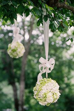 hydrangea pomanders like this in green and ivory/white or in ivory roses with greenery for the chapel to hang at alter along with draped white material.