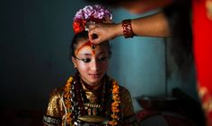 Kumari Samita Bajracharya, aged 10, receives her third eye on her forehead from her mother Purna before the Rato Machindranath chariot festival, also known as Bhoto Jatra, in Jwalakhel, on the outskirts of Kathmandu, Nepal. The festival is considered to bring rain, good harvest, prosperity and good luck and is mainly celebrated among farmers. Photograph: Narendra Shrestha/EPA