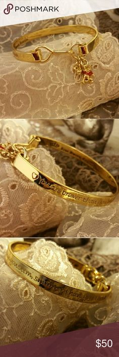"""RARE Disney Couture Winnie the Pooh Charm Bracelet Beautiful gold finished bangle bracelet with charms by Disney Couture. The cuff reads """"You are braver than you believe, stronger than you seem, smarter than you think."""" Perfect for anyone who needs a little positivity in their day. A little bee and a red shirted Pooh bear dangle from the hook clasp. This bracelet is sized for smaller wrists. Original dust bag included. Worn once, excellent condition, no flaws. Disney Couture  Jewelry…"""