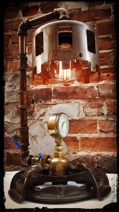 Up-cycled brass pipes and a reclaimed 1940's Thelander clutch turned into an amazing light!