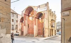 "Unparelld'arquitectes has turned four buttresses supporting a party wall in the town of Olot, Spain, into an arched public shelter and performance backdrop that aims to ""catalyse activity"" on the street. The Buttress, Metal Cladding, Shelter Design, Brick Arch, Church Of Our Lady, Urban Life, Amazing Architecture, Architecture Interiors, Dezeen"