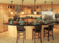 Canyon Creek Cornerstone - Shaker in Maple with a Cinnamon stain contemporary kitchen. I really like the island, but make it all counter height!