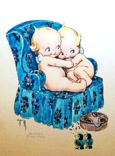 Kewpie's Snuggling in Blue Chair