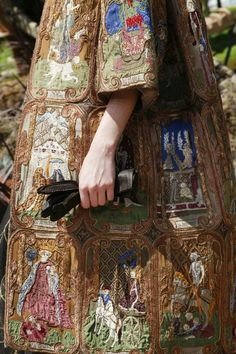 """via @fourredshoes """"Christian Dior couture for autumn 2017 includes a coat of applique medieval tarot cards"""