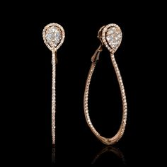 18k rose gold hoop earrings, feature 184 round brilliant cut white diamonds of F color, VS2 clarity and excellent cut and brilliance, weighing 1.50 carats total.