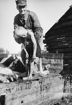 A Finnish soldier retrieves civilian casualties killed by Soviet partisans during the Finnish-Soviet Continuation War. German Boys, Lest We Forget, Interesting History, World History, World War Two, Wwii, Crime, The Past, Pictures